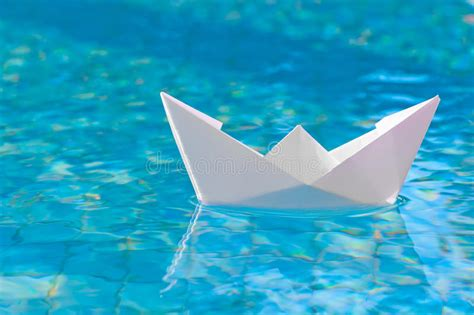 Floating Boat Picture by White Paper Boat Floating In The Water Stock Photo Image