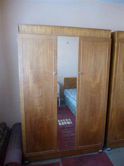 Wooden Wardrobe With Mirror by Wooden Door Wardrobe With Centre Mirror In