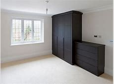 Dark wood modern fitted wardrobes Bespoke Furniture