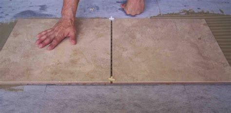 how to lay floor tiles installing tile over a wood subfloor today s homeowner