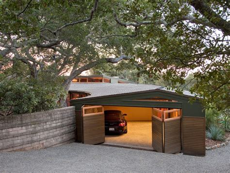 Decomposed granite driveway garage modern with two car