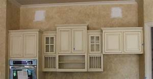 Extensive white kitchen cabinets with grey glaze and black for Kitchen colors with white cabinets with yankees wall art