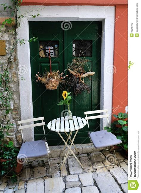 front door chair table and chairs outside the front door stock photo image 32915390