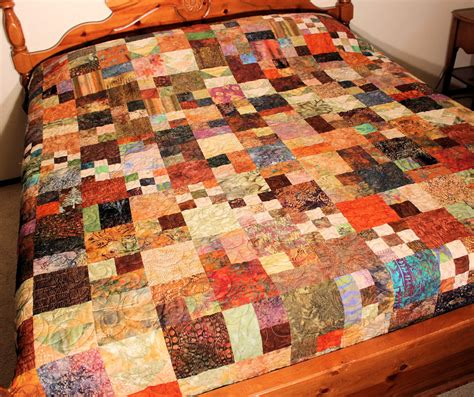 masculine queen size bed quilt fall migration in batiks