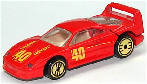 The red scuderia is detailed with yellow stripes and ferrari logos on the sides and top. Ferrari F40 RedUHgld