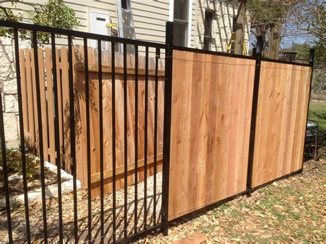 iron and wood fence custom wrought iron fence transitioning into privacy cedar fence new amsterdam ironworks