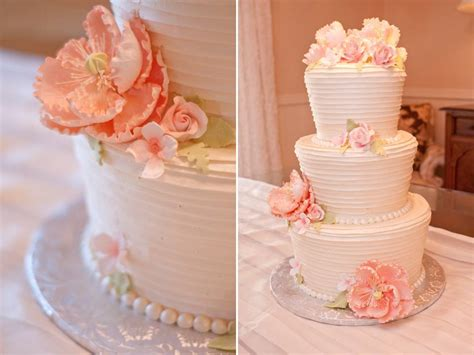 Romantic White And Peach Wedding Cake With Pearl Accents