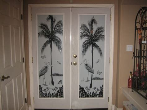 tropical door scene herons cove  wallpaper  windows hot    windows  doors etched glass door tropical doors