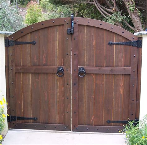 magnificent brown color convex shape wooden gate and