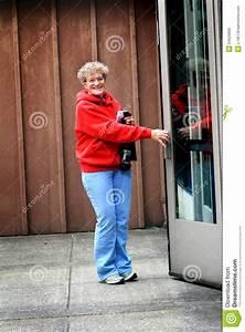 Older Lady Opening Door Stock Photo - Image: 54526805