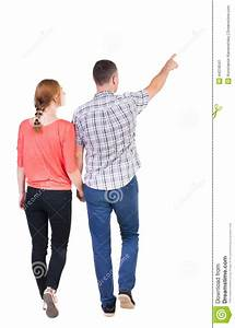Back View Of Walking Young Couple (man And Woman) Pointing ...