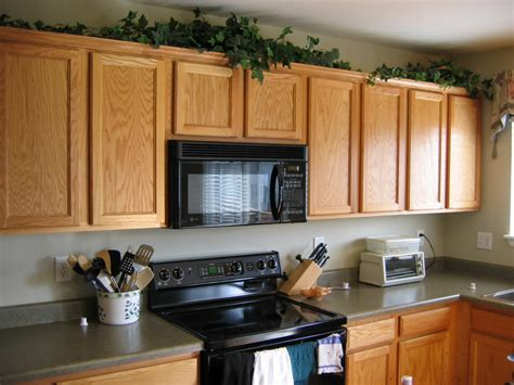 decorating ideas for above kitchen cabinets tips decorating above kitchen cabinets my kitchen