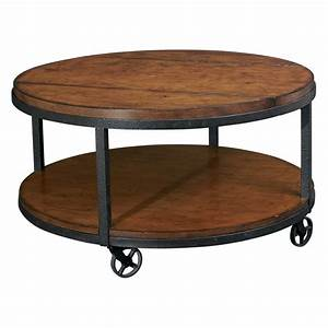 Round shaped wooden coffee table with wheels black metal for Rustic circle coffee table