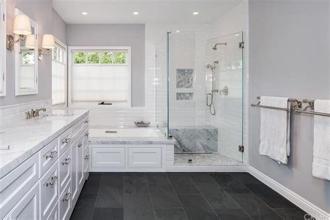 traditional master bathroom with complex marble counters