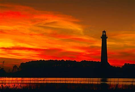 sunset  bodie island lighthouse    implies