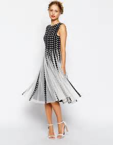 fit and flare wedding guest dress asos spot mesh insert fit and flare midi dress asos the merry