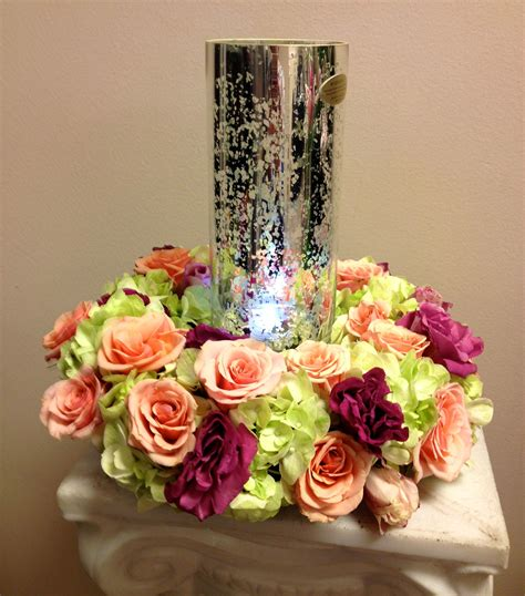 lovely wreath  flowers   glass hurricane candle