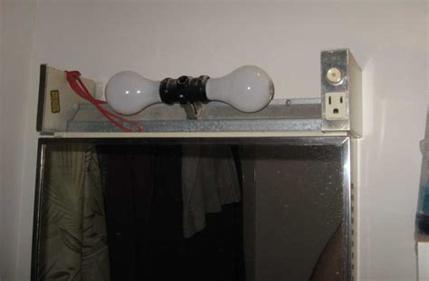 bathroom light fixture with outlet astonishing bathroom light fixtures with electrical