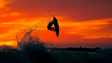 Catching Some Air At Sunset Photo By Chris Burkard