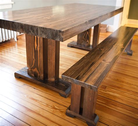 dark butcher block dining table with long backless bench