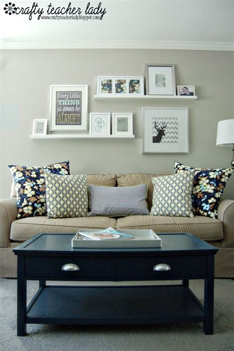 """Fortunately, this season's decoration ideas above the sofa cover the best of design trends, from funky beach houses to elegantly repurposed antiques. """"Gallery Wall"""" above the sofa - I like the floating shelves as an easy way to switch out ..."""