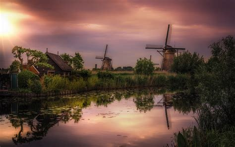 windmills  kinderdijk   province  south holland netherlands sunset dusk channel