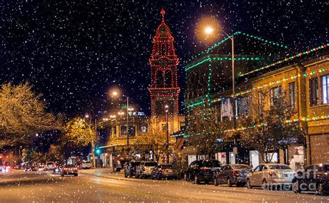 snow on the plaza lights photograph by carolyn fox