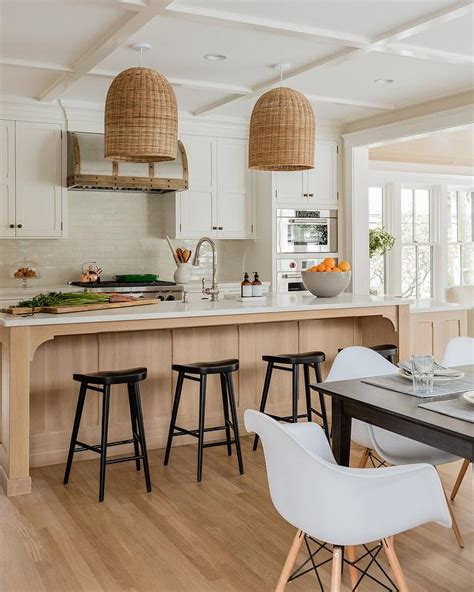 white cabinets  blond wood center island