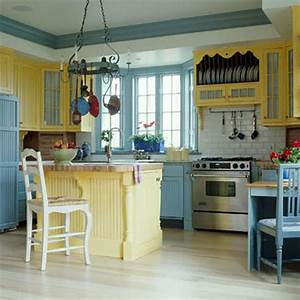 Transitional coastal kitchen with bold blue island hgtv for Kitchen cabinets lowes with coastal wall art on wood