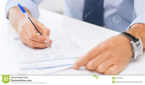 Man Filling Tax Form Stock Photo  Image 52740045