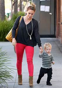 Hilary Duff tries to coax her little man Luca onto his ...