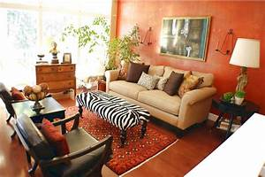 african themed living room with yellow wall panel and With african style living room design