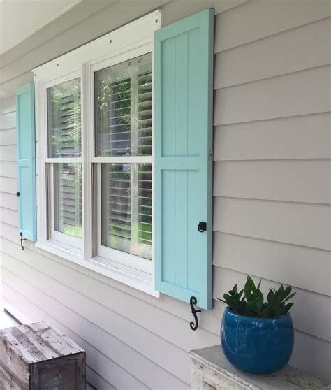 custom aquamarine board n batten shutters architectural