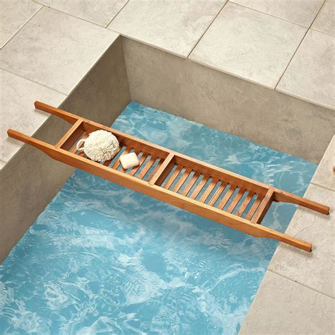 teak wood bathtub caddy the genuine teak tub caddy hammacher schlemmer