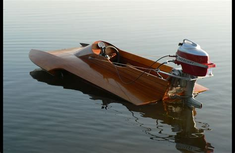 Round Wood Boat by A Wooden Speed Boat