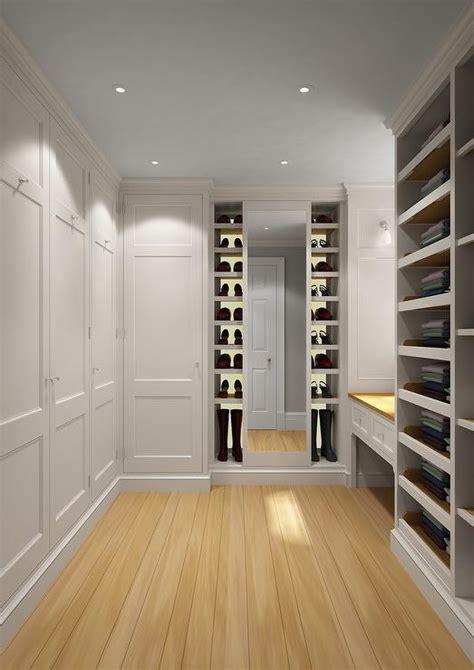built in shoe shelves with mirrored backsplash