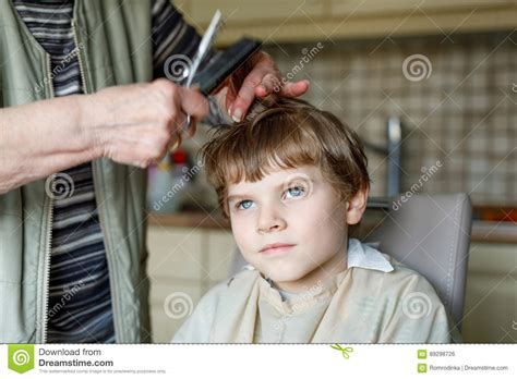Beautiful Kid Boy With Blond Hairs Getting His First Haircut. Stock Photo Short Sides Medium Top Haircut Fade With Part Designs Guys Long On Shaved Styles Black Men High White Man Layered Haircuts For Thick Hair 2017 Cute Emo Length