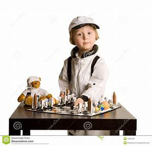 Astronaut Boy Playing Chess Stock Image - Image: 13657601