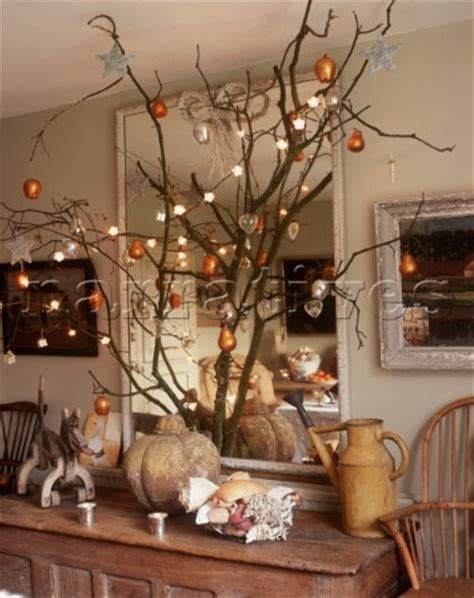 pe056 15 christmas decorations on branch in front of