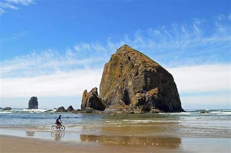 beach biker haystack rock cannon beach oregon