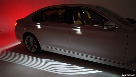 bmw welcome light carpet how does it work image 448827