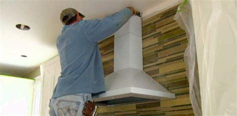 installing tile backsplash  range hood  kuppersmith