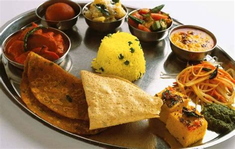 types of indian cuisine thali a large plate with various indian food with