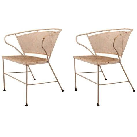 pair of metal mesh garden chairs attributed to woodard for