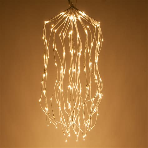 white falling willow lighted branches  warm white led