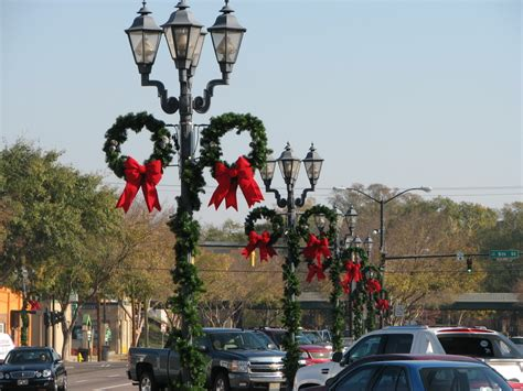 side pole mount wreaths downtown decorations