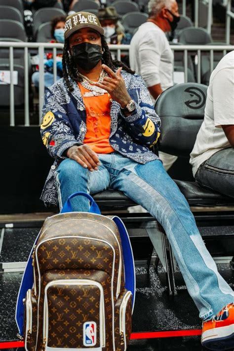quavo wearing  chanel  pharrell tee   richard mille lvxnba bag incorporated style