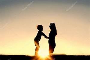 Silhouette of Mother and Young Child Holding Hands at ...