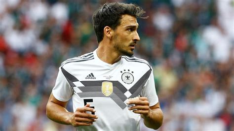 Mats hummels of germany celebrates with the world cup trophy after defeating argentina 1−0 in extra time during the 2014 fifa world cup brazil final match. Germany's Hummels fit for South Korea clash