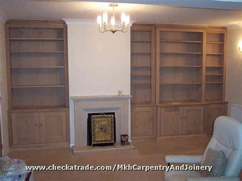Cabinet /shelves built either side of a chimney breast